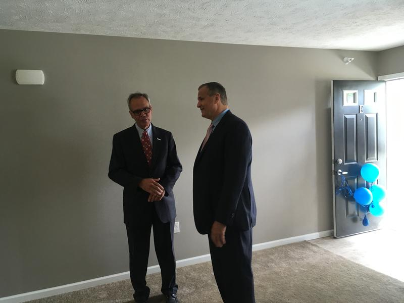 Dennis Mouras (man on right), CEO of UnitedHealthcare Community Plan of Michigan tours one of the Prestwick Village Apartment units.