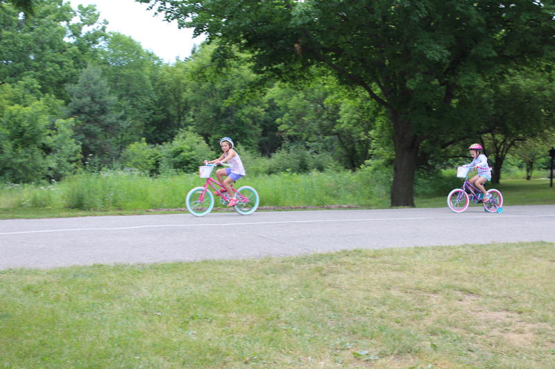 Children biking around the campground.