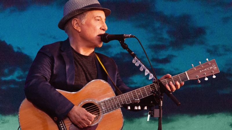 Paul Simon with guitar