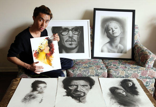 Razmin Ahmadzada poses with some of his artwork