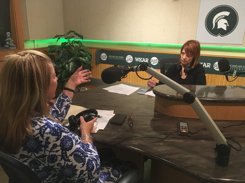 Williamston mayor Tammy Gilroy (foreground) interviewed by WKAR's Brooke Allen (background)