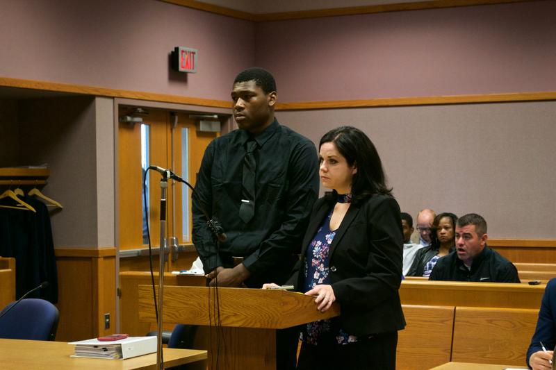 Former MSU football player Joshua King (left) standing in court with his attorney Shannon Smith (right).