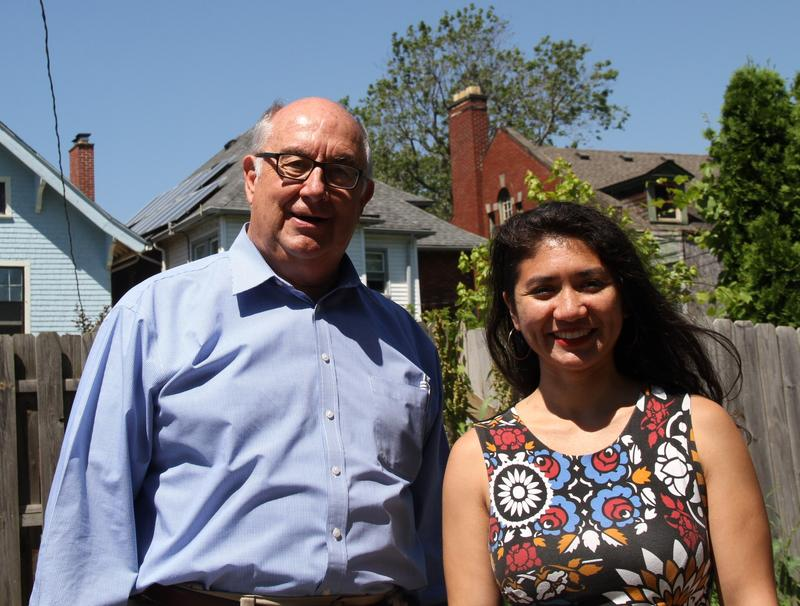 Kirk Heinze, Alessandra Carreon. The solar panels on Ale's home can be seen above Heinze's right shoulder.