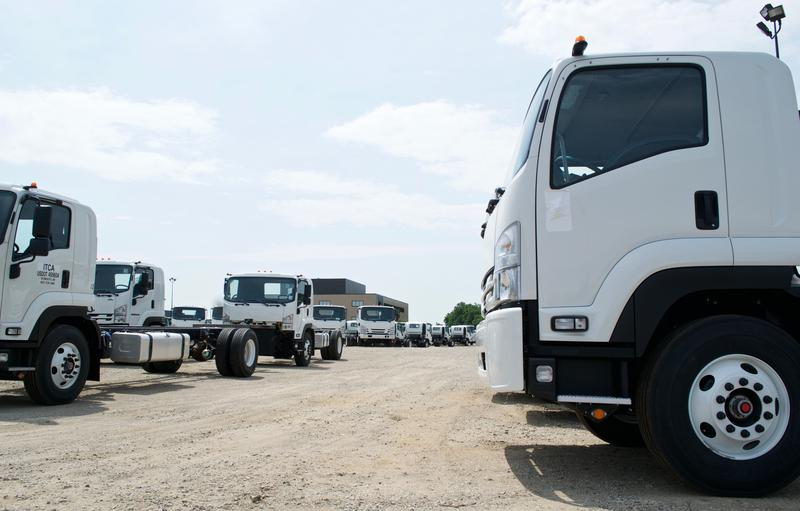 Spartan Motor's lot of Isuzu trucks.