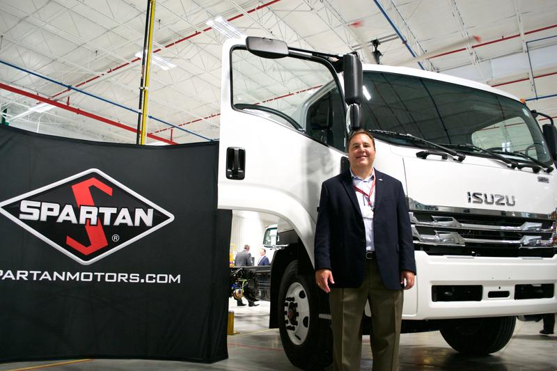 Spartan Motor's Steve Guillaume with one of the new Isuzu trucks.