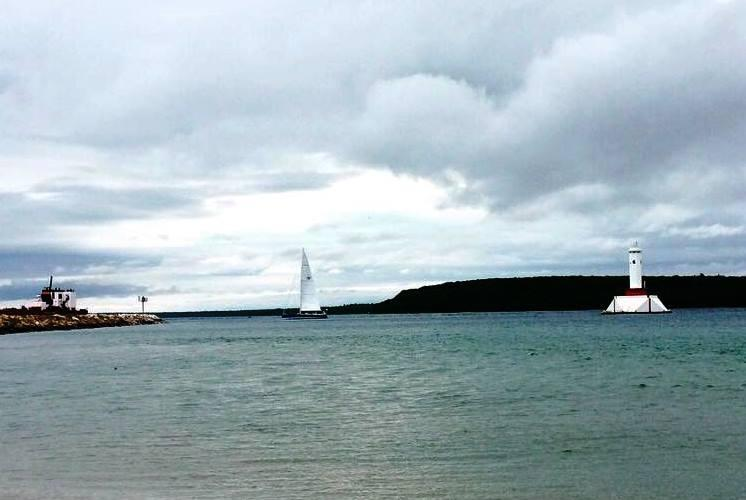 Picture shows Infinite Diversion being the first to finish the 109th Chicago Yacht Club Race to Mackinac.