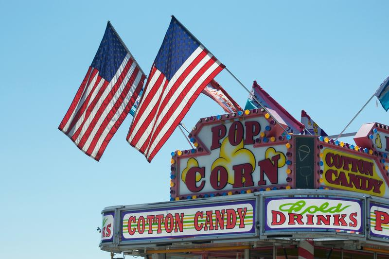 American flags flying atop a popcorn vendor.