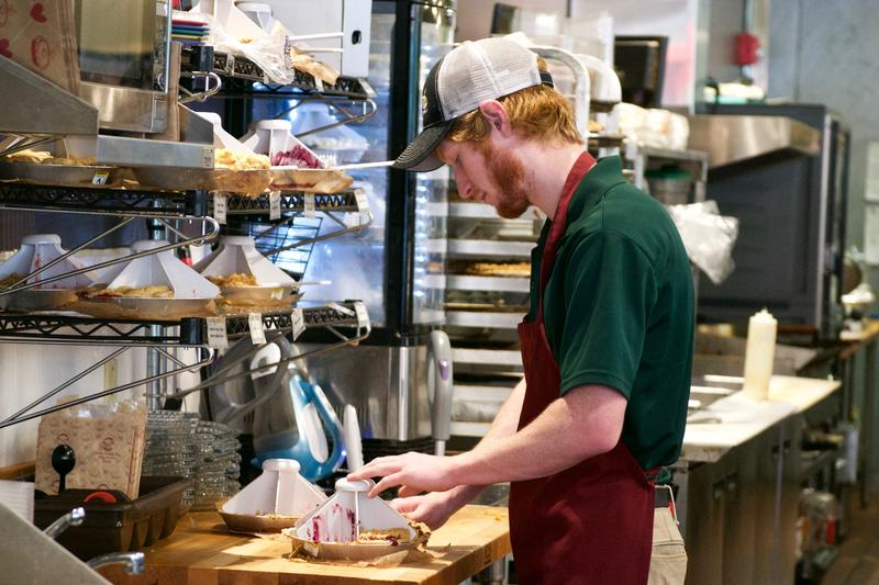Grand Traverse Pie Company worker carves up popular Vernors Cherry pie.