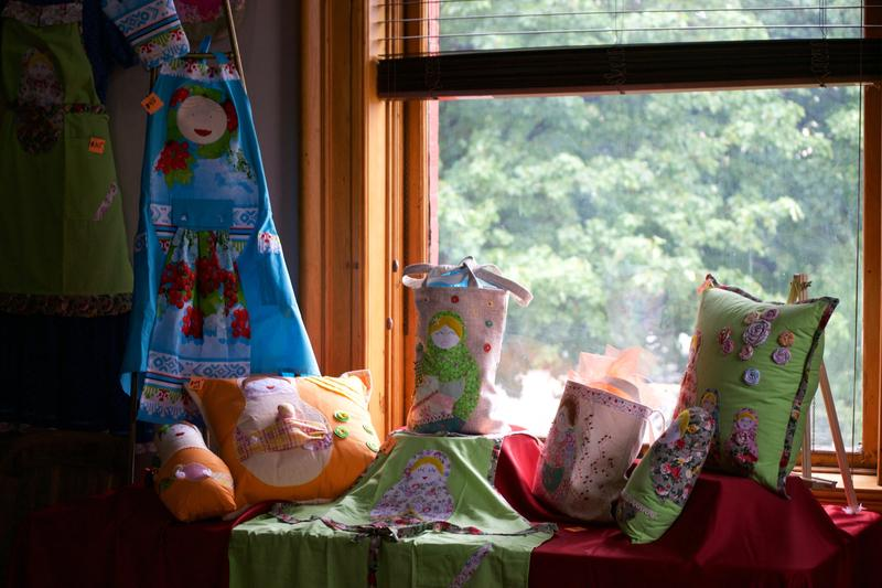 Handmade dolls, pillows, and aprons.