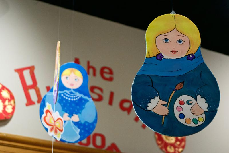Hand-painted cutouts of Russian nesting dolls hang from the ceiling.