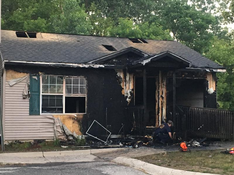 Fire damaged unit at Edgewood Villas apartments in South Lansing.