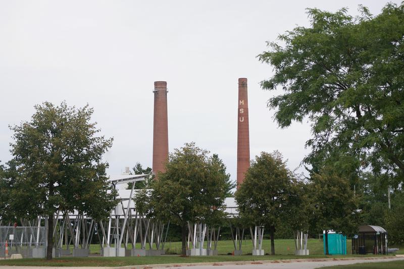 The T.B. Simon Power Plant overlooks the new solar panel carports.
