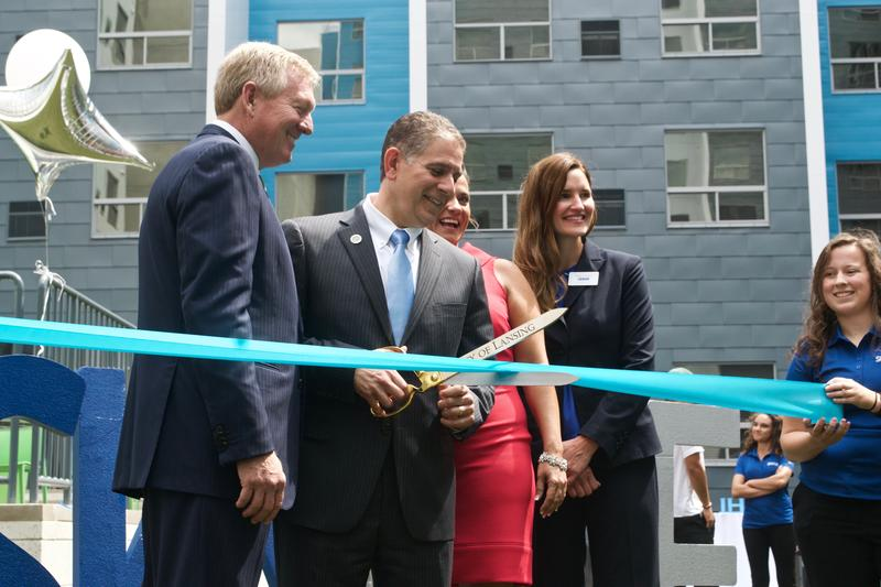 (Left to Right) Randy Churchoy, Mayor Virg Bernero, Katie Larner and Sarah Rainero cut the ribbon.