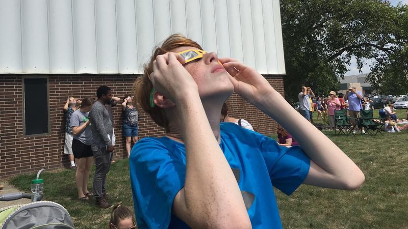 Holt High School student Eli Sharkey views solar eclipse on August 21, 2017.