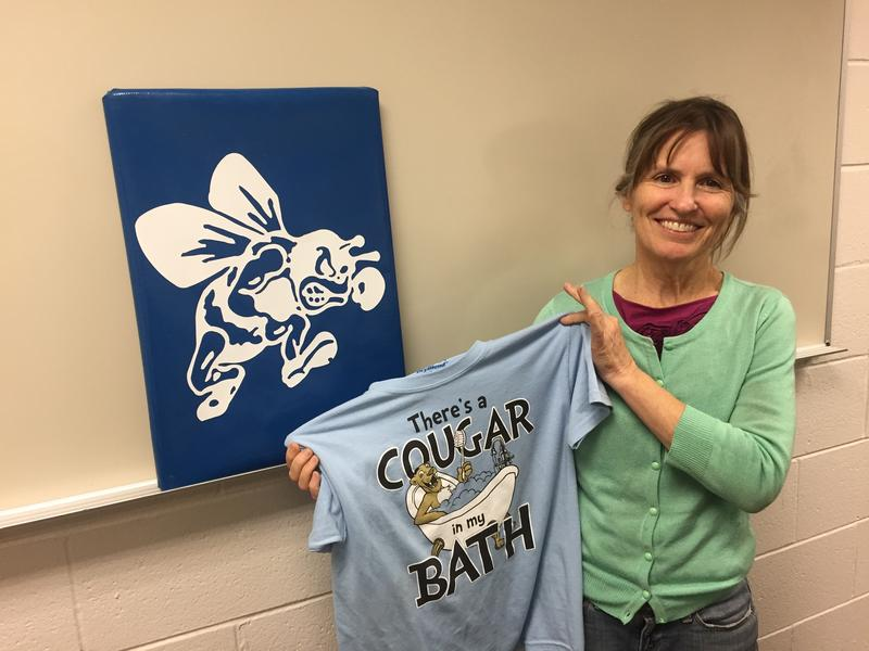 MaryAnn Boylan shows off the cougar shirt she made with her students.