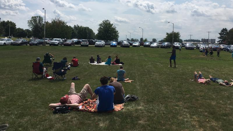 Families gather on the lawn of the MSU Observatory to watch solar eclipse on August 21, 2017.