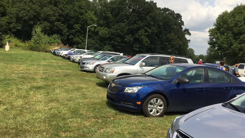 Full parking lot outside of the MSU Observatory. Many came to view solar eclipse on August 21, 2017.