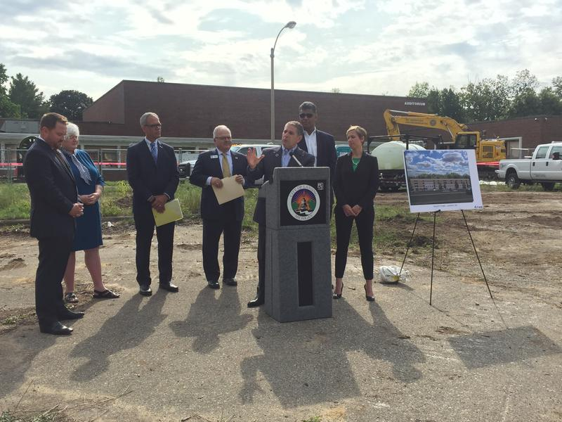 Lansing mayor Virg Bernero (center at podium) at construction kick-off ceremony.