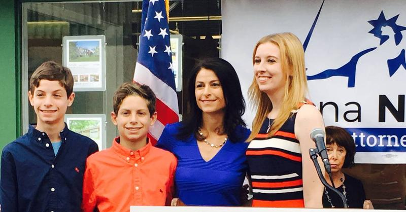 Civil-rights attorney Dana Nessel (center in blue) poses with family members on the announcement of her Attorney General campaign.