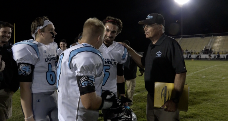 Lansing Catholic HS Head Football Coach Jim Ahern (far right) and a few players from the team. Someone stole 20 phones from the team's lockerroom as they played Waverly High School on Friday night.