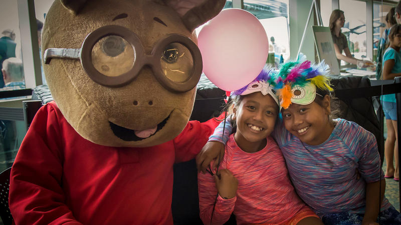 Arthur with kids at the MSUFCU Kids Day!
