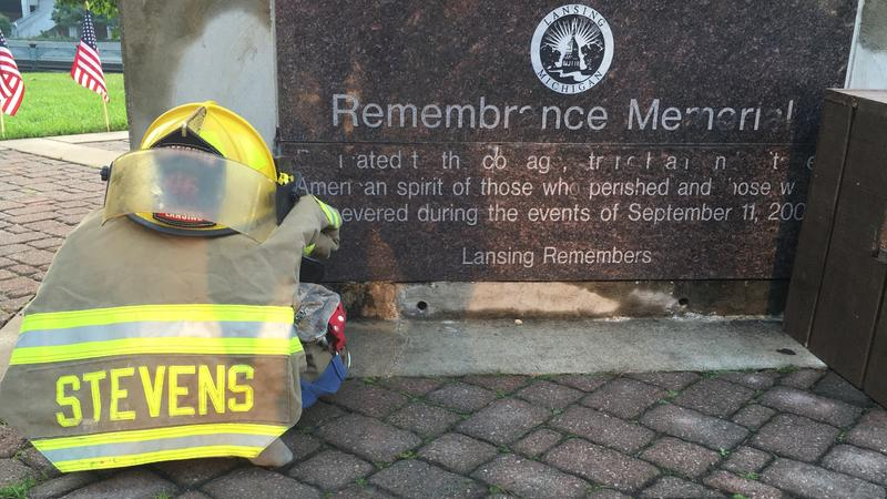 Firefighter's gear sits at Lansing 9/11 Remembrance memorial.