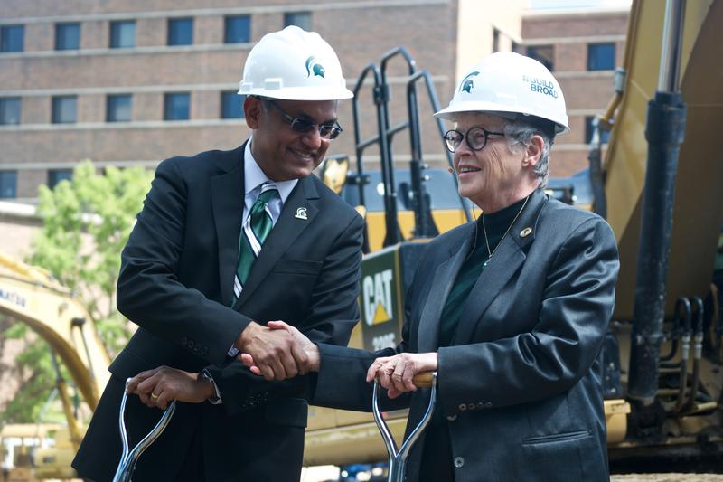 Sanjay Gupta, Dean of the Eli Broad College of Business (left) shakes hands with MSU President Lou Anna K. Simon (right) at groundbreaking for MSU Business Pavilion on Sept. 8, 2017.