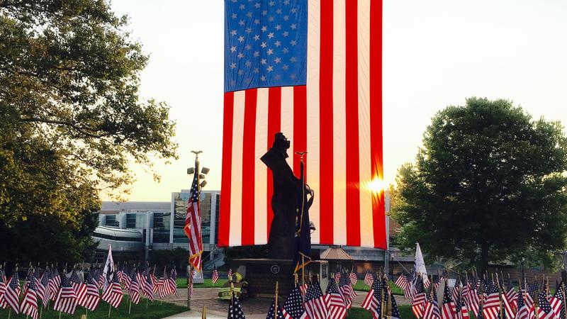 U.S. flag is suspended above Rememberance plaza in Lansing.