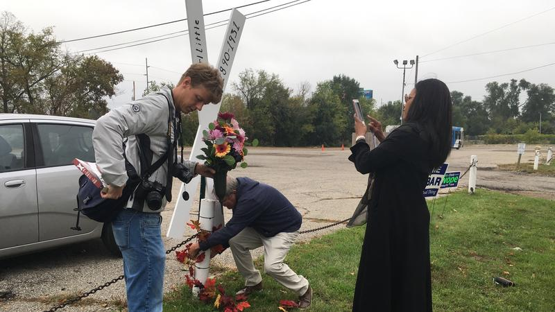Ilyasah Shabazz takes picture of an X bearing the name of her grandfather, the Rev. Earl Little.