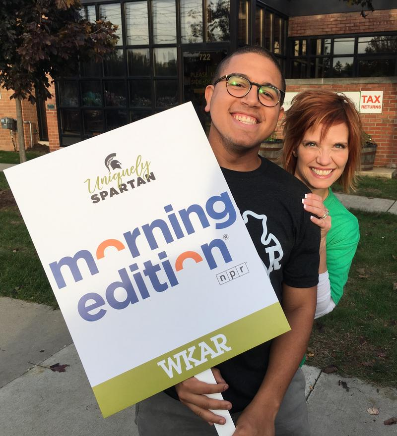 Morning Edition intern Sergio Martinez Beltran and host Brooke Allen have some fun before the parade.