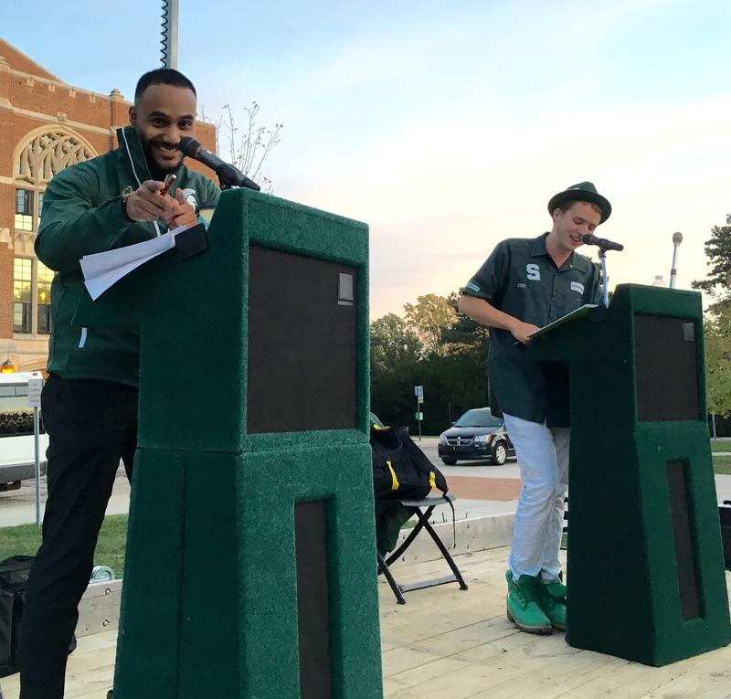 WKAR's Al Martin (left) and Isaac Constans (right) co emcee the parade.
