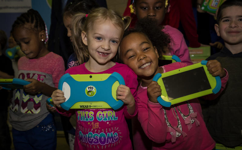 Kindergartners holding their PSB Kids Playtime Pad at school