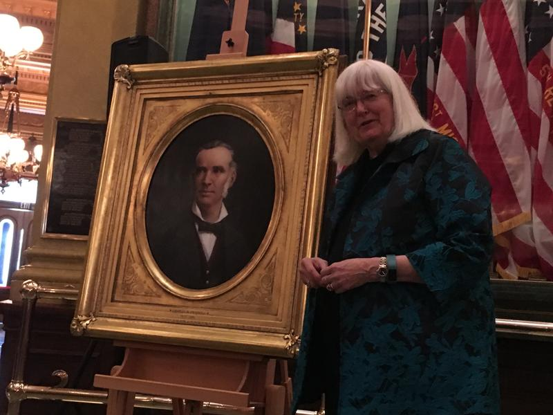 Priscilla Croswell Grew stands next to the newly unveiled portrait of her great grandfather, Governor Charles Croswell.