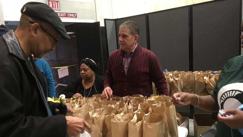 Virg Bernero photo distributing free meals.