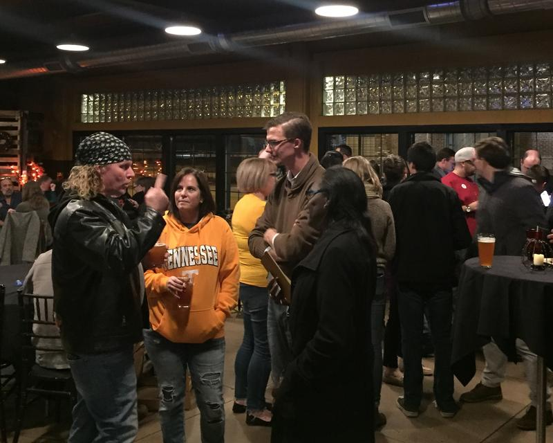 Derek Dobies (center) at his watch party at Grand River Brewery Tuesday night.