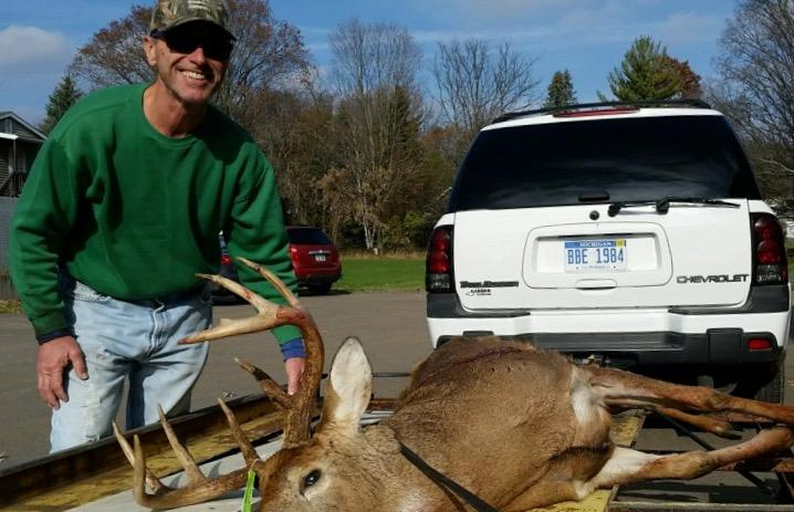 David Lagalo of Saginaw shows off a 10-point buck he shot in Eaton County.