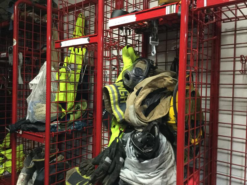 Lansing firefighters' gear inside Station 44.