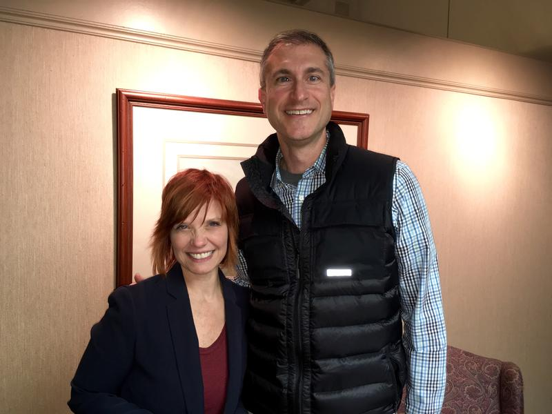 WKAR's Brooke Allen (left) stands next to Ann Arbor mayor Christopher Taylor (right)