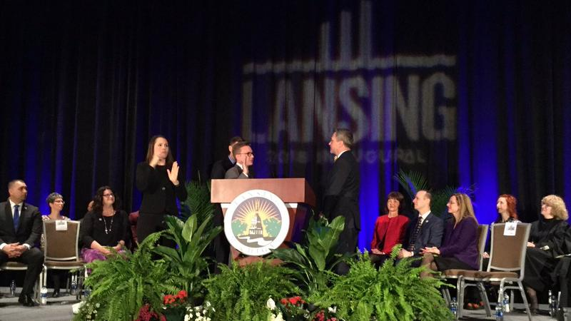 Lansing council member Peter Spadafore takes oath on January 1, 2018.