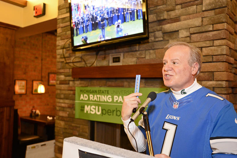 Bob Kolt speaks to the group of faculty rating ads at least year's Super Bowl ad rating party