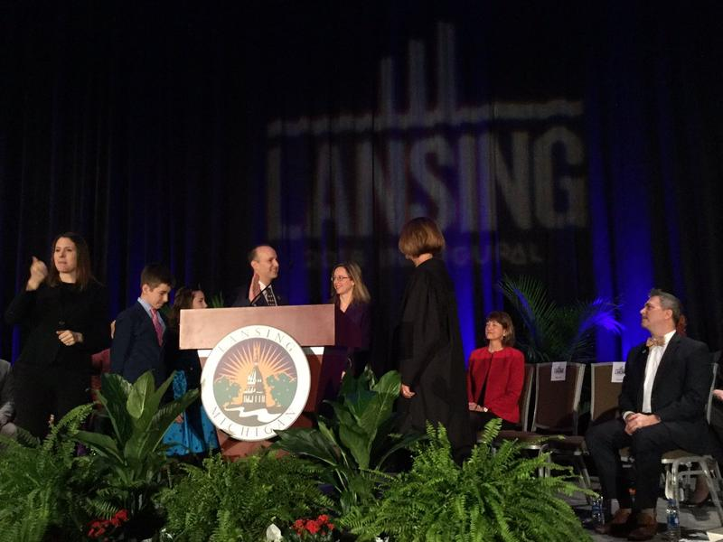 Lansing mayor Andy Schor takes oath on January 1, 2018.