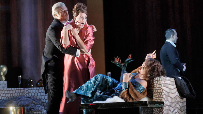 "Rod Gilfry as Alberto Roc, Amanda Echalaz as Lucia de Nobile, and Christine Rice as Blanca Delgado in Adès' ""The Exterminating Angel."""