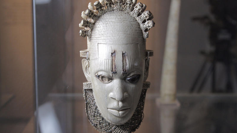 Carved Ivory mask-shaped hip pendant, inlaid with bronze Benin, Queen Idia, Artisit Unknown (16th century) – British Museum, London.