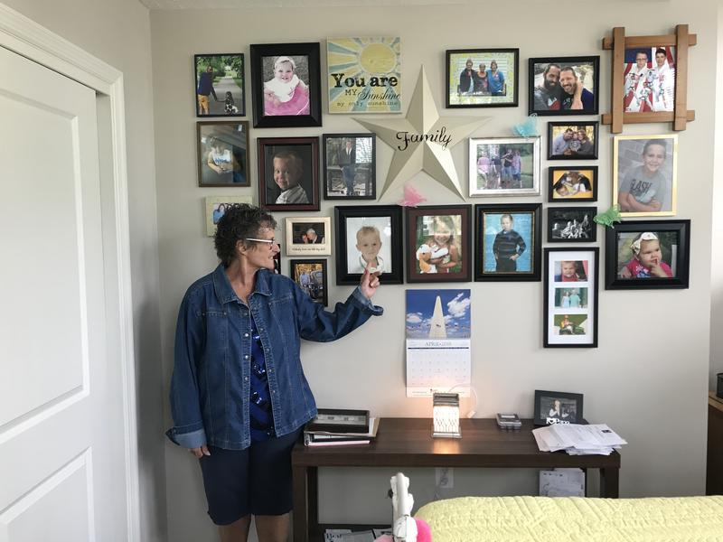 Diane Schafer dedicated a wall in her bedroom to family photos.