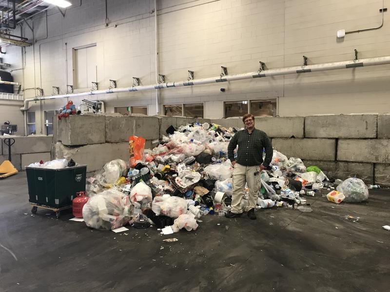 Operations Manager Sean Barton stands in front of one day's worth of plastic.