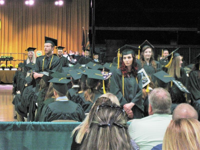 Students at Northern Michigan University stood up and turned their backs as Gov. Rick Snyder spoke at their commencement.