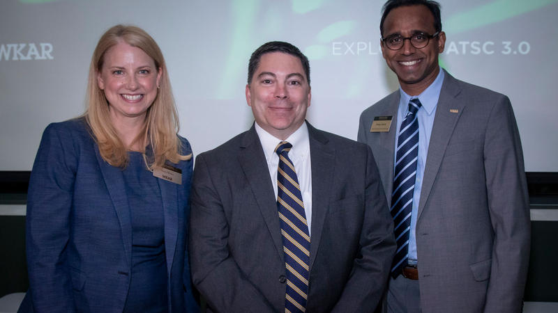 Susi Elkins, director of broadcasting and general manager of WKAR, and Prabu David, dean of the College of Communication Arts and Sciences, pose with FCC Commissioner Michael O'Rielly.