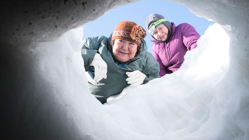 Mimi and her granddaughter prepare to enter an ice cave in Canadian Artic.
