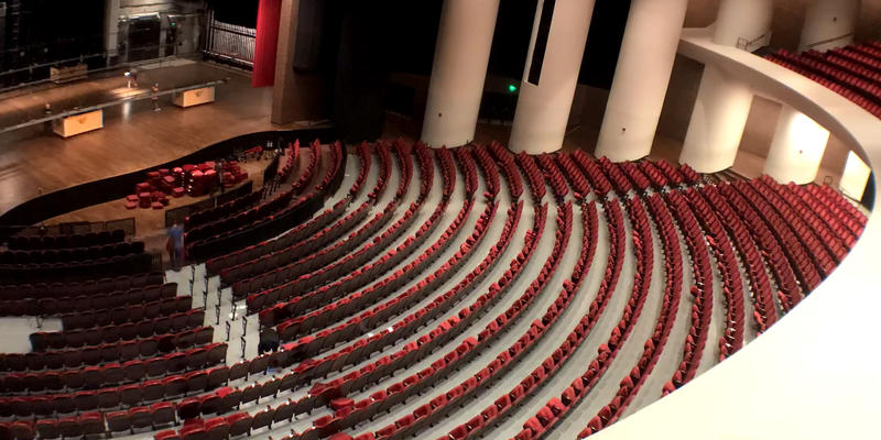 Stage Hands of the Wharton Center mid-removal of select seats to create temporary aisles for the incoming production of The Lion King