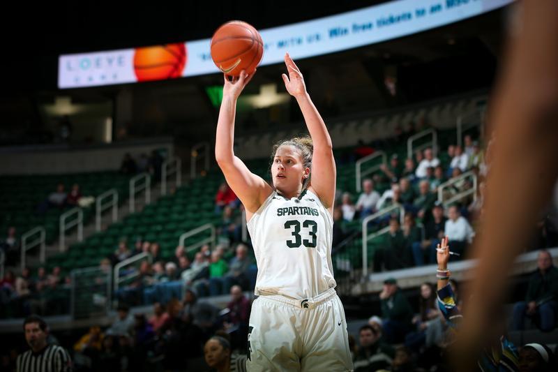 Jenna Allen shoots a 3-pointer against Minnesota
